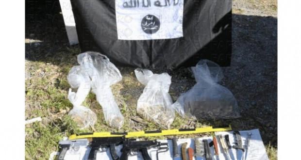 صناديق ممتلئة بالأسلحة مدفونة تحت الأرض